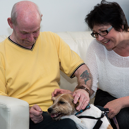 Image of service user with a dog