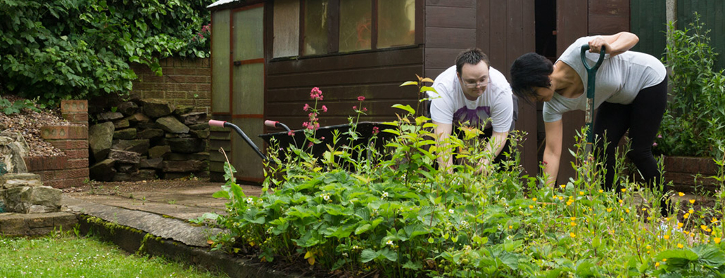Image of service user doing gardening
