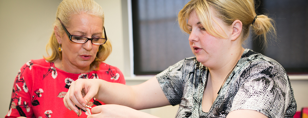 Image of service user completing a craft project