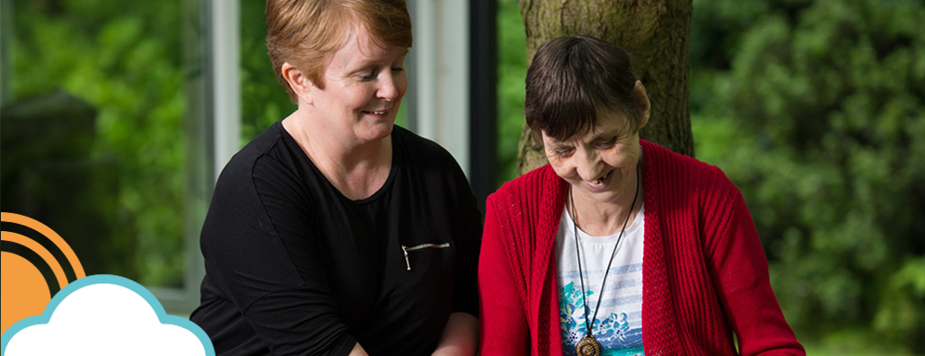 Image of service user and Sun Healthcare employee in the garden