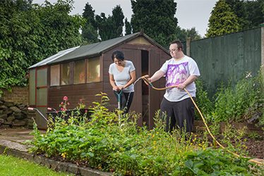 Image of service users in the garden