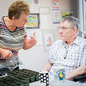 Image of service user and Sun Healthcare employee