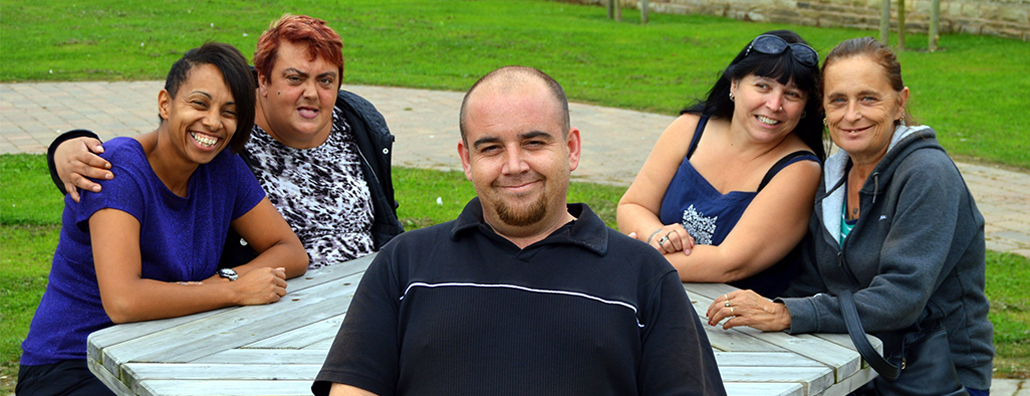Image of service users and Sun Healthcare employees at a picnic table