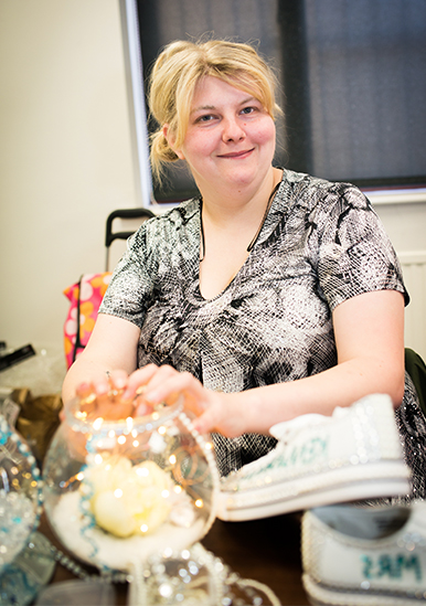 Image of service user with craft project