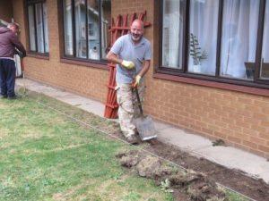 Man digging, spade