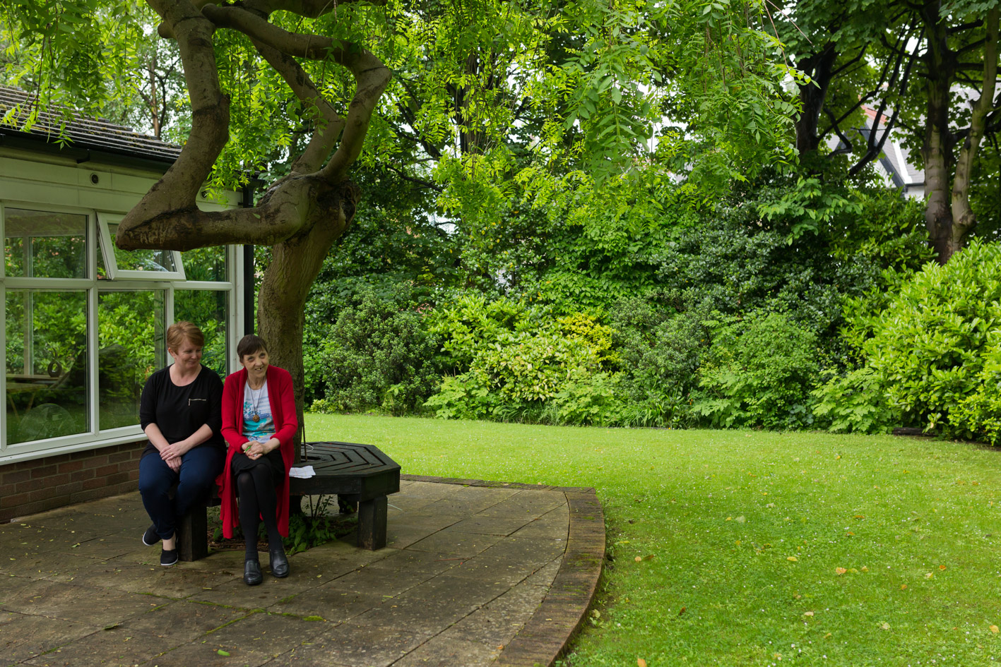 Shaftsbury House, garden, ladies sitting under tree, learning disability
